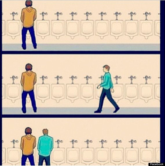 Two Men Standing Too Close at Urinal